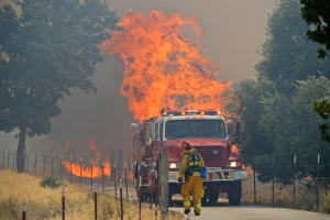 http://www.contracostatimes.com/ci_23578027/pittsburg-firefighters-battle-grass-fire-near-kirker-pass (Jose Carlos Fajardo/Bay Area News Group)